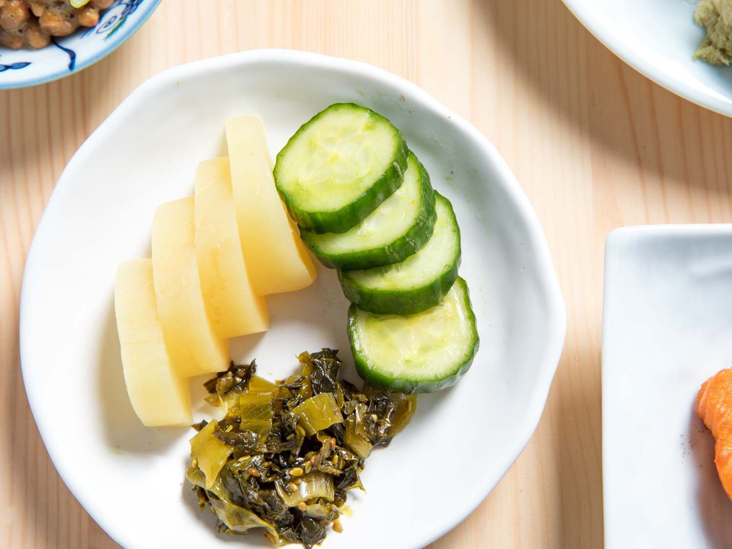 Pickled daikon, quick-pickled cucumbers, pickled mustard leaf