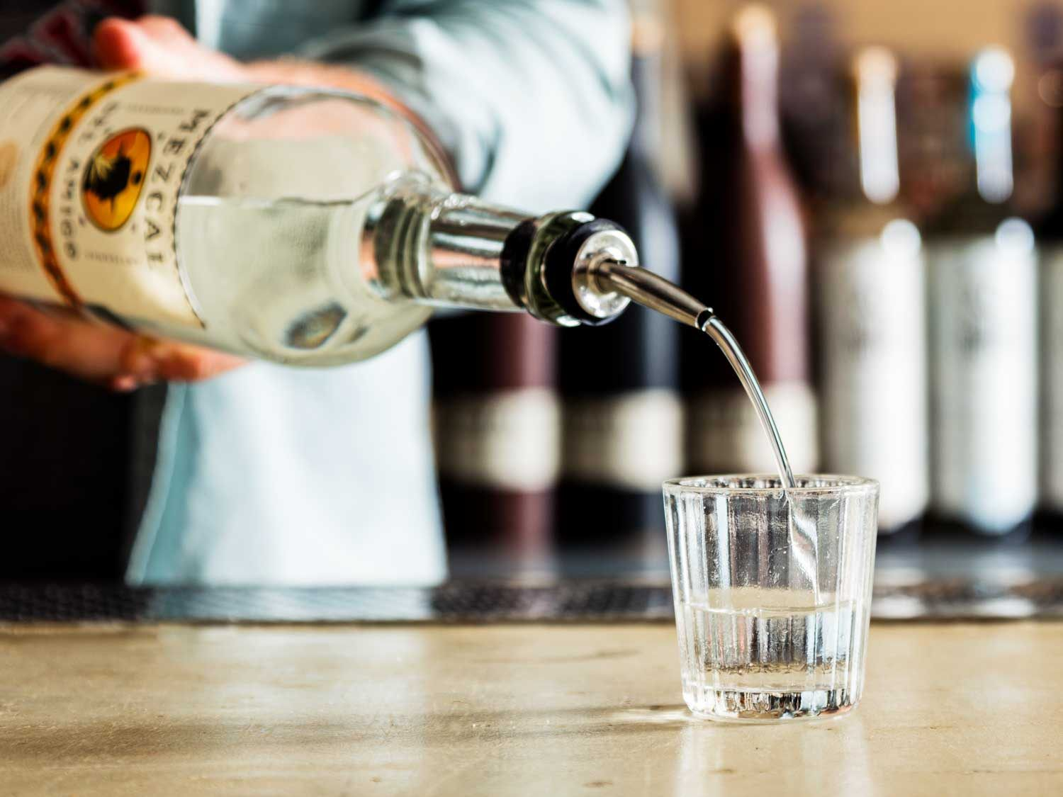 glass-of-mezcal-poured-at-a-bar