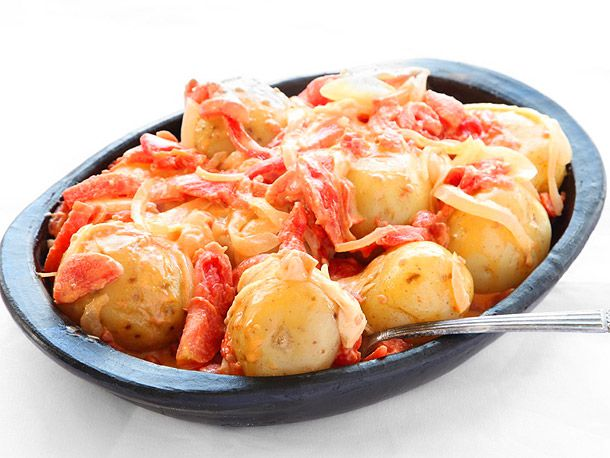 Papas Chorreadas (Colombian Potatoes with Cheese and Tomato Sauce)
