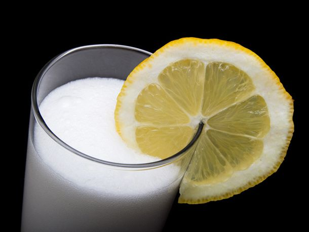 Ramos Fizz cocktail with lemon slice