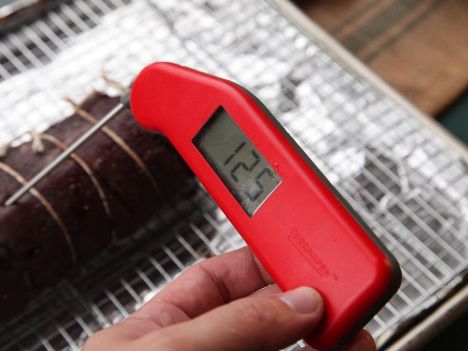 An instant-read thermometer showing the temperature of a roast