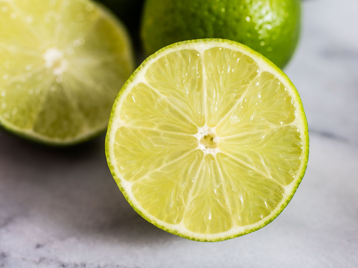 A close up of a lime that's been cut in half.
