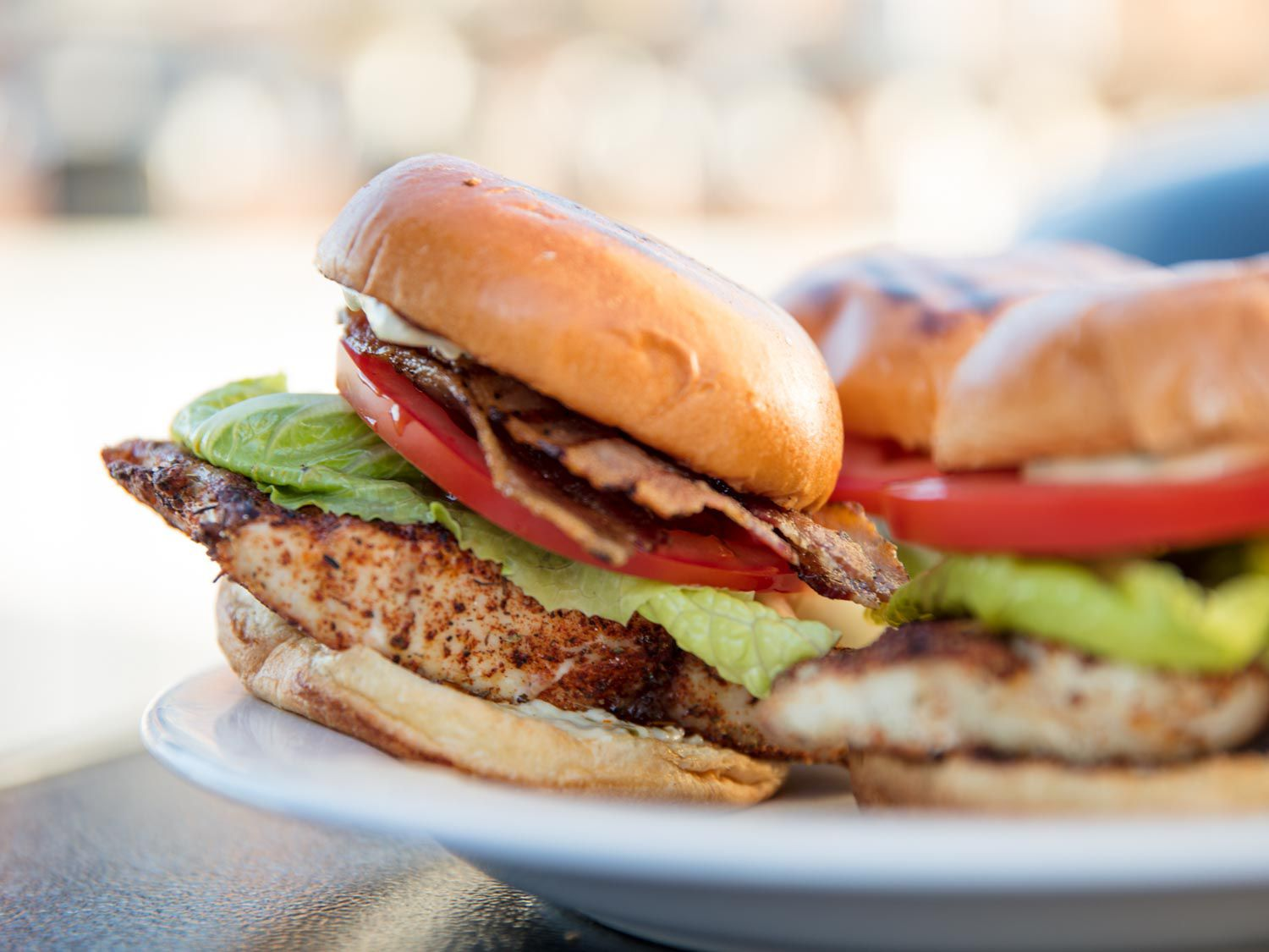 Grilled blackened fish sandwiches with lettuce and tomato