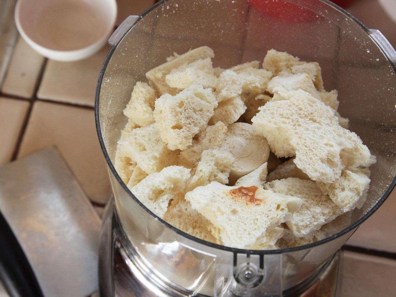 Chunks of crustless bread in food processor bowl