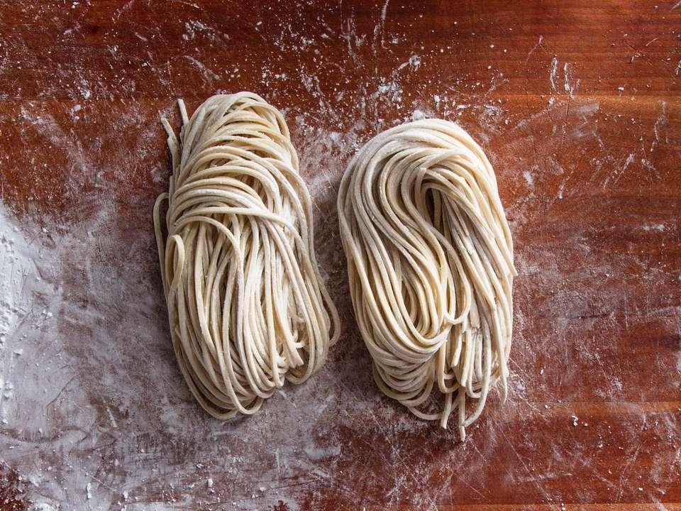Two bundles of freshly made ramen noodles