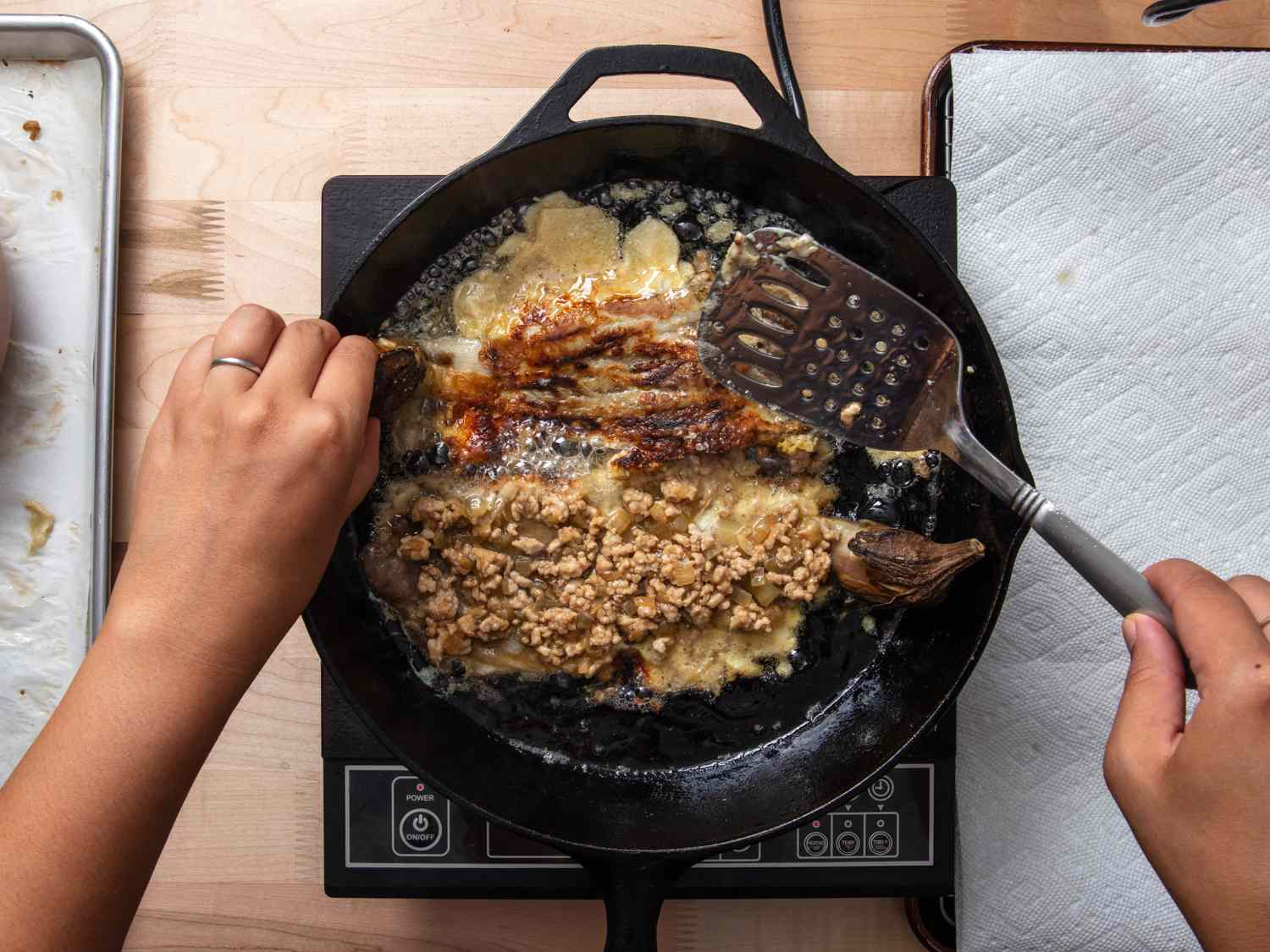 tortang talong cooking in cast iron skillet