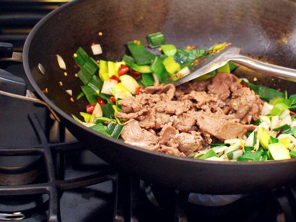 stir-frying beef, onions, and leeks