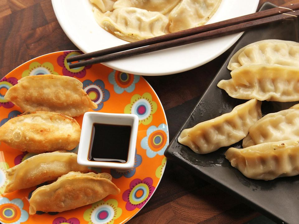 Serving plate of fried and steamed dumplings.