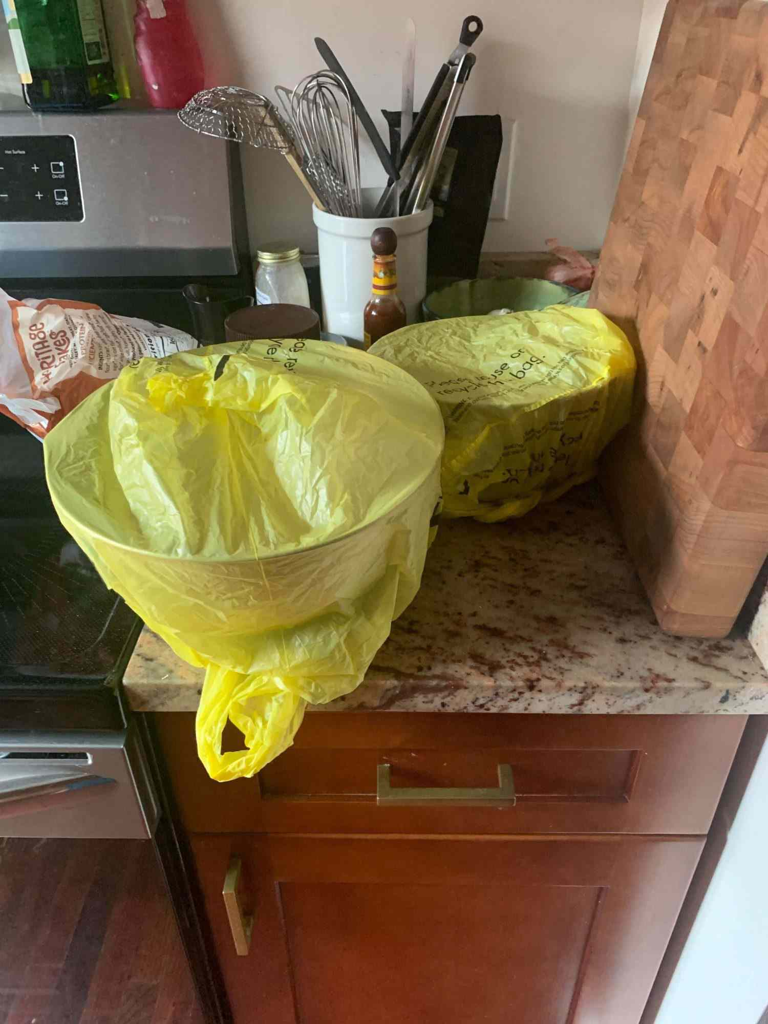 Bowls wrapped in plastic grocery bags