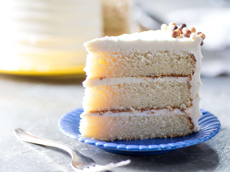 slice of three layer cake with Swiss meringue buttercream