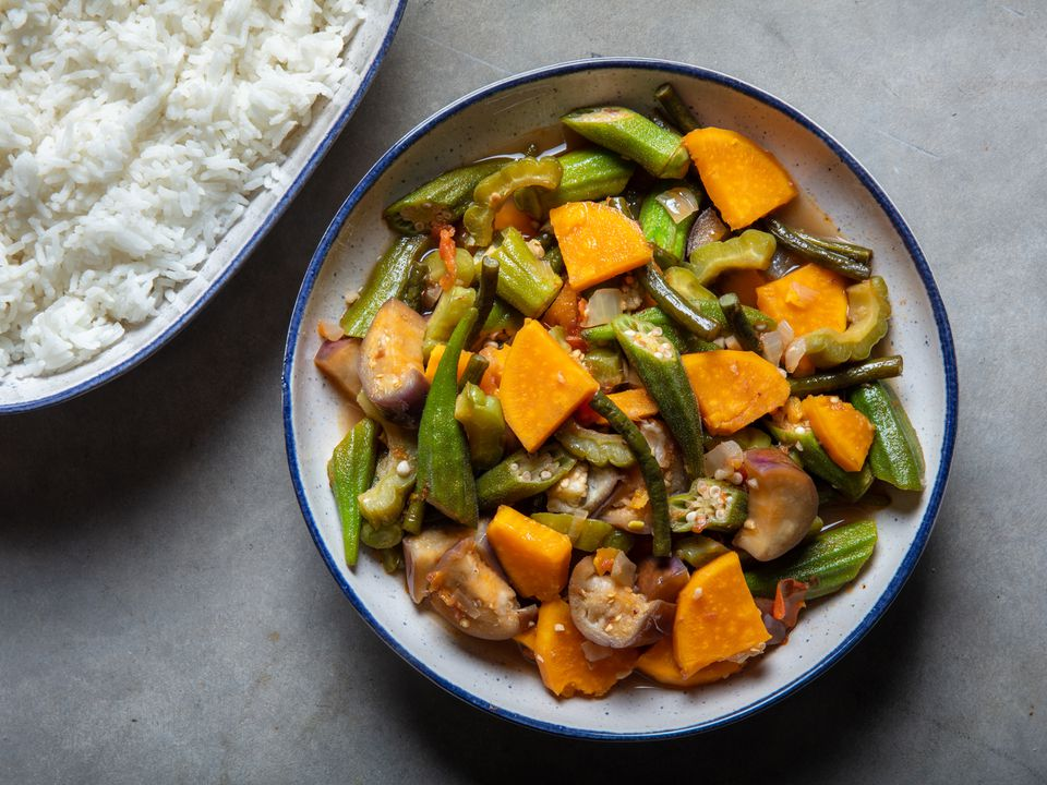 a serving bowl of pinakbet with a side of rice