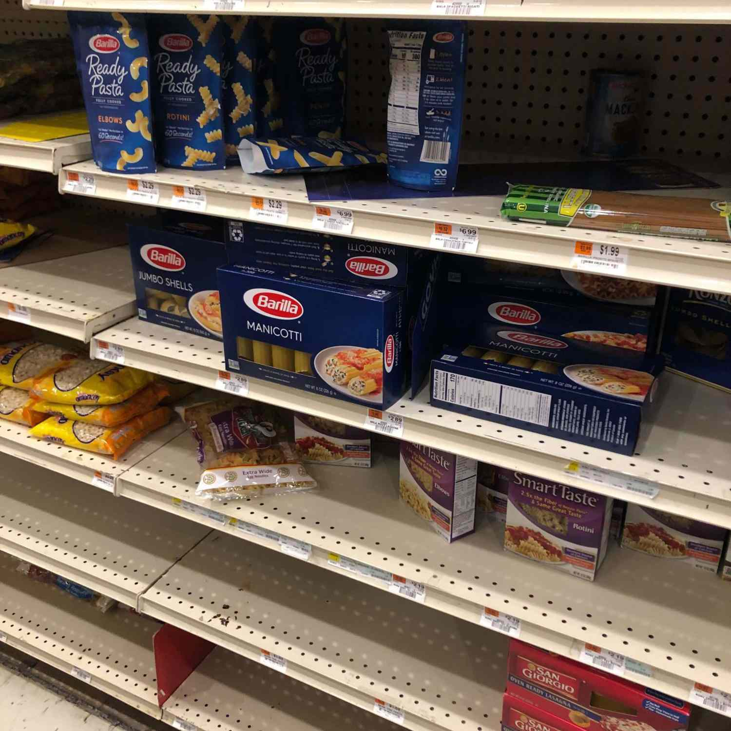Grocery shelves with only manicotti remaining