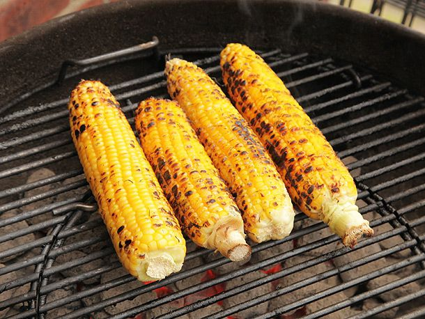 shucked corn on the grill
