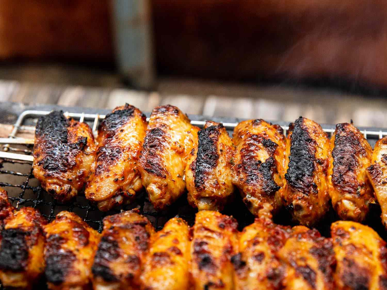 Closeup of Turkish-style wings grilling on a Japanese konro grill