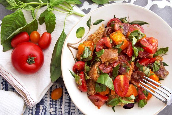 Panzanella salad with tomatoes and basil in a bowl.