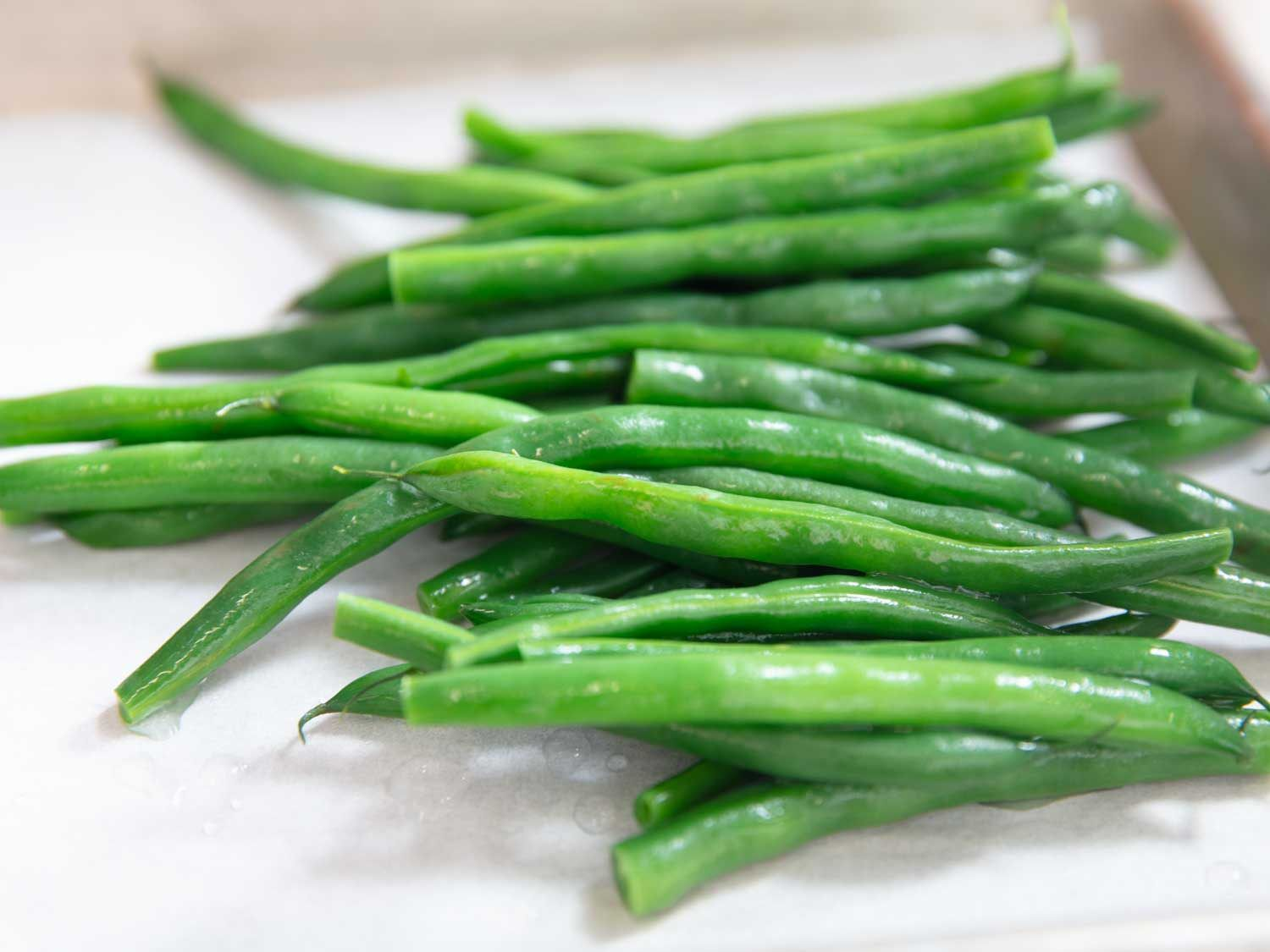 Closeup of blanched whole green beans.