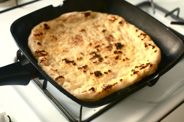 cooked pizza dough on grill pan