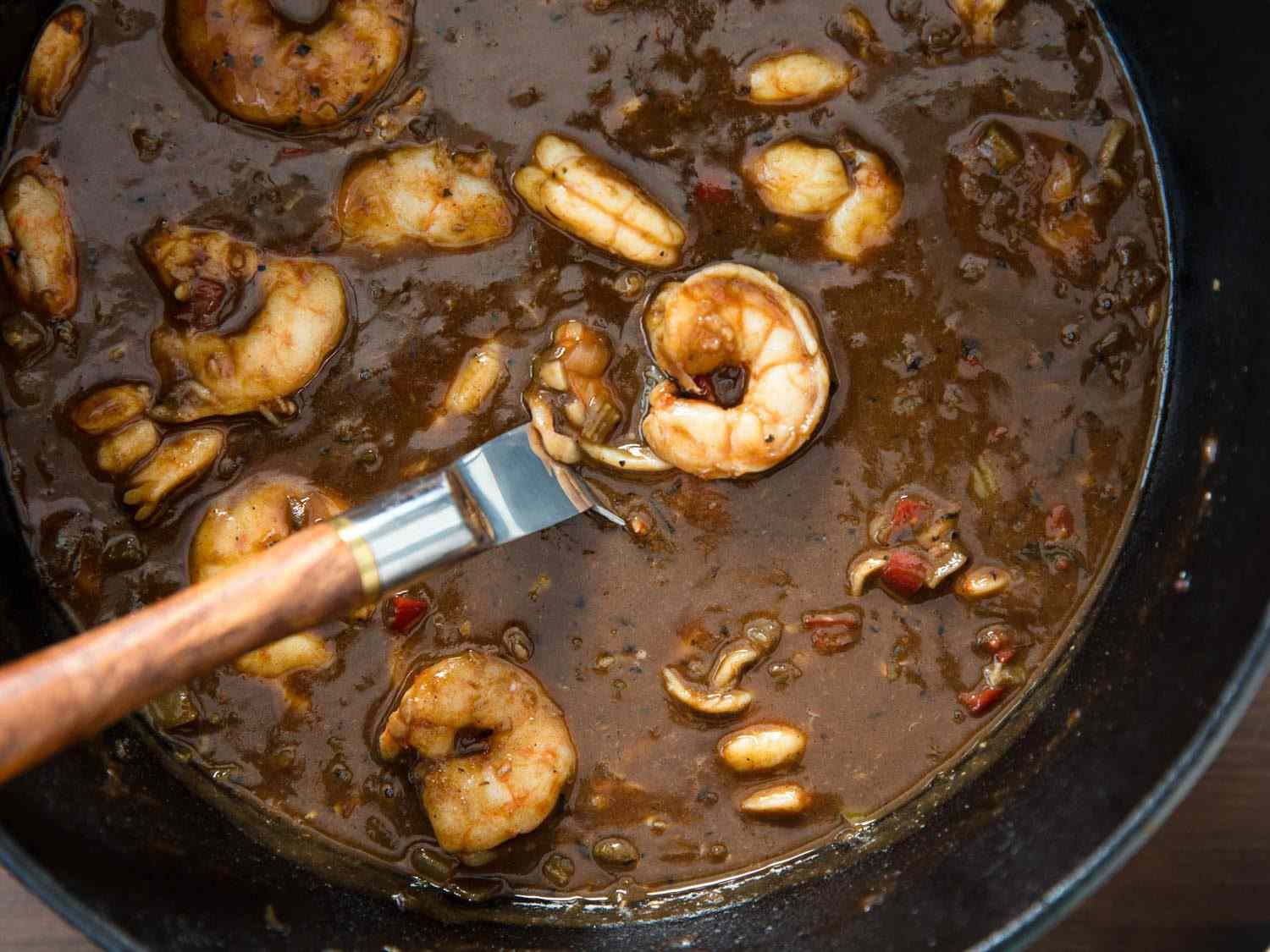 shrimp etouffee in the pot, made with a dark brown roux