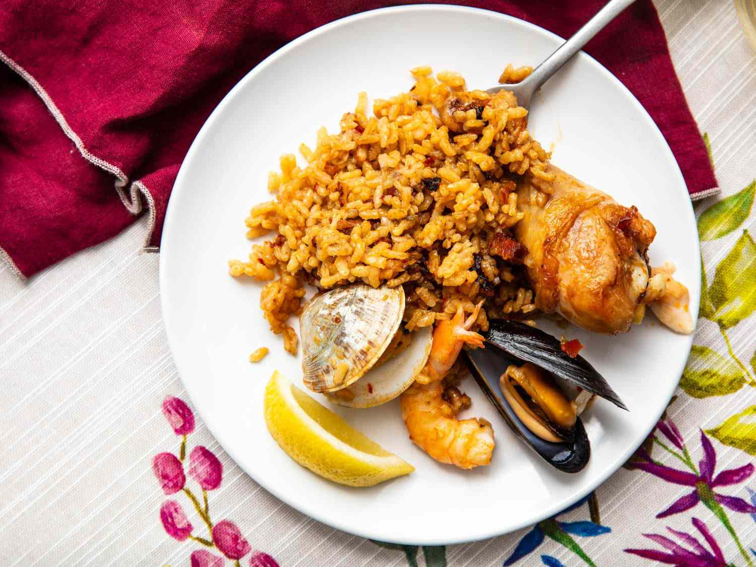 A serving of paella on the plate, showing how the rice grains remain separate when done.