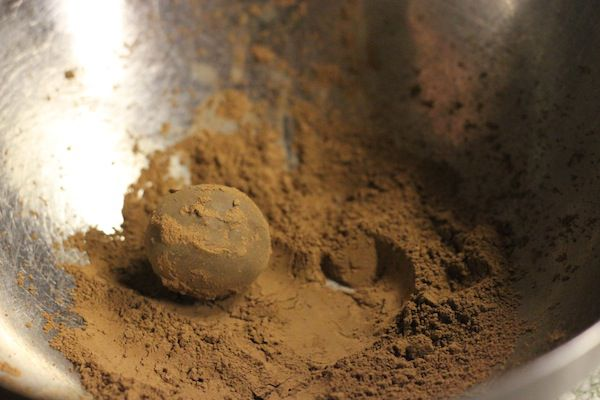 roll ganache in coating to finish truffles