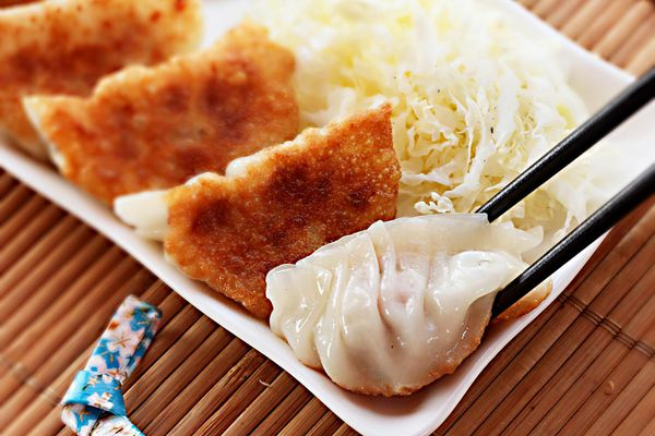A small platter of Japanese pork and cabbage gyoza or dumplings.