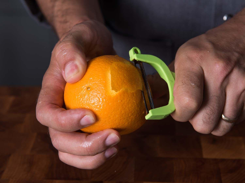 Peeling the zest from an orange