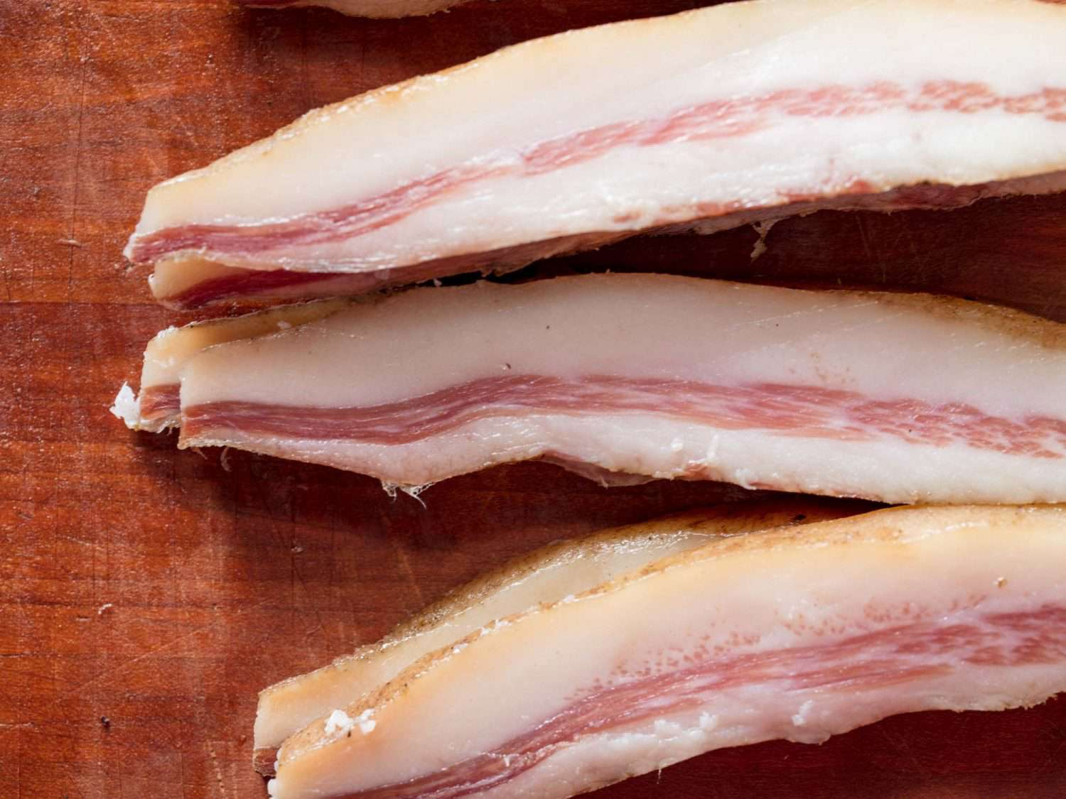 Thick slices of uncooked guanciale