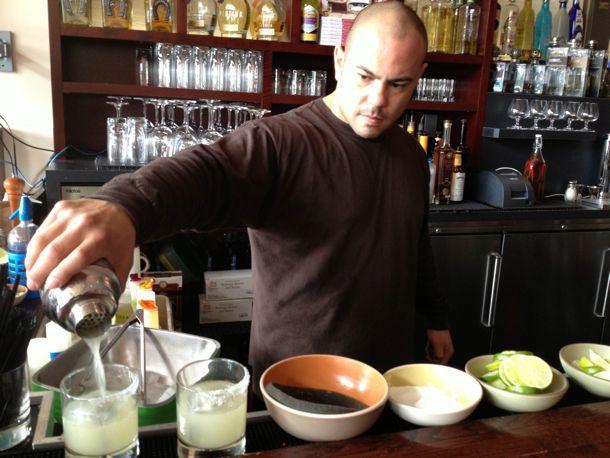 bartender pouring margaritas