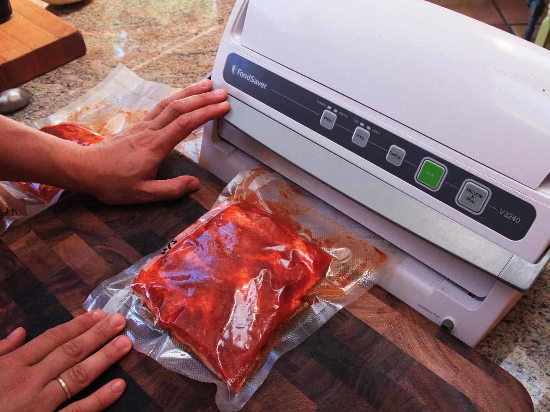 Vacuum-sealing pork ribs before cooking sous vide