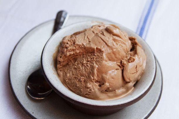 A small bowl of chocolate frozen custard.