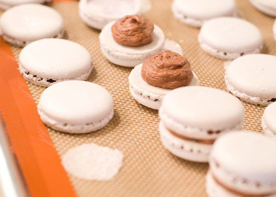 piped filling onto macarons