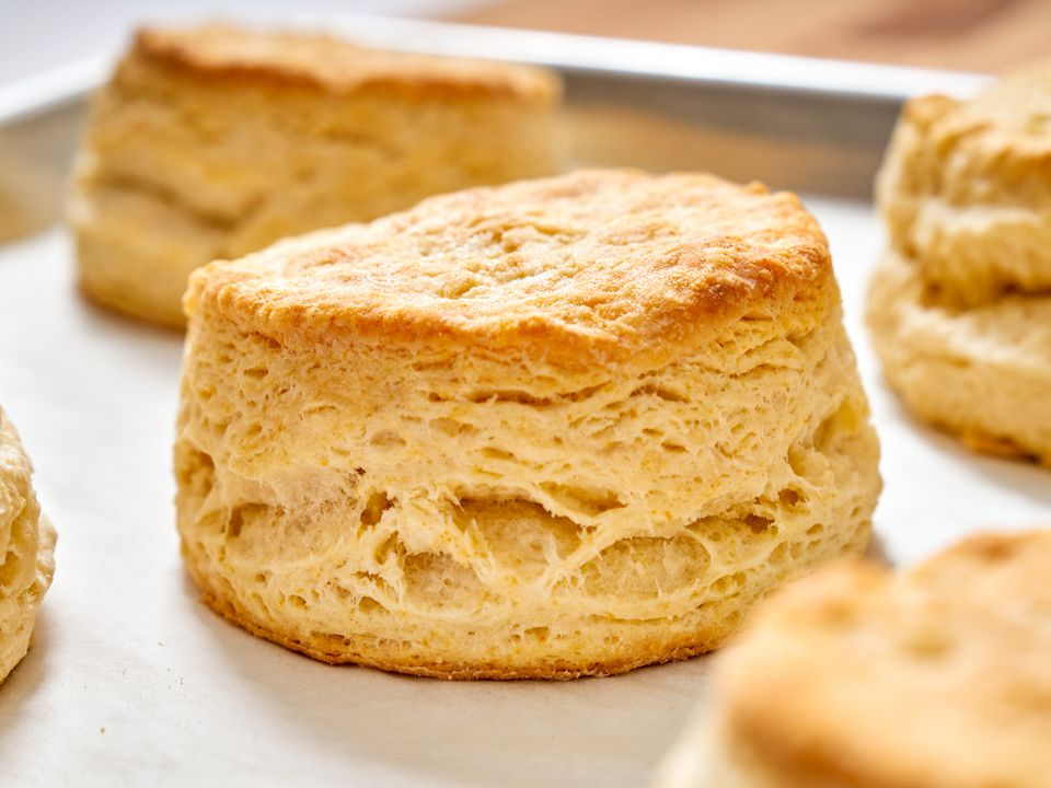 A close up of a freshly baked buttermilk biscuit