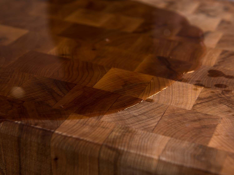 mineral oil soaking into wood board