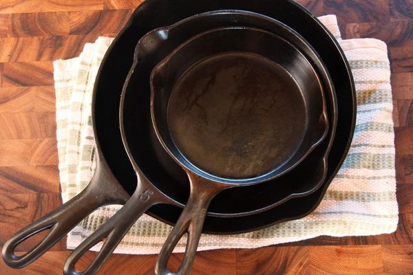 Three cast iron skillets nested for storage