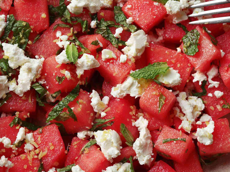 Close-up of cubed watermelon, mint, feta, and lemon zest.