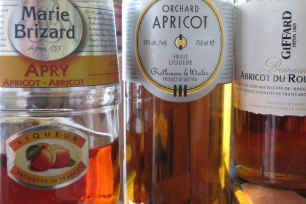 An assortment of bottles of apricot brandy