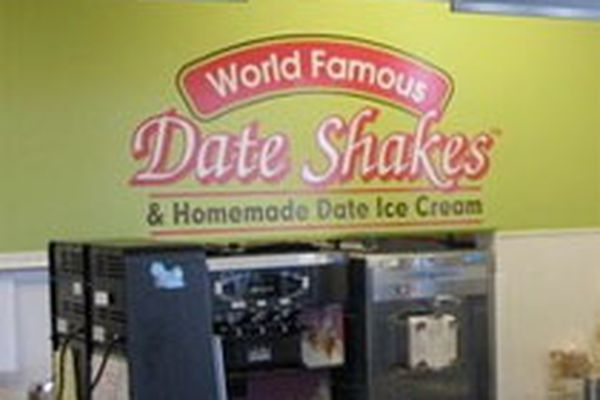 Sign for date shakes and date ice cream.