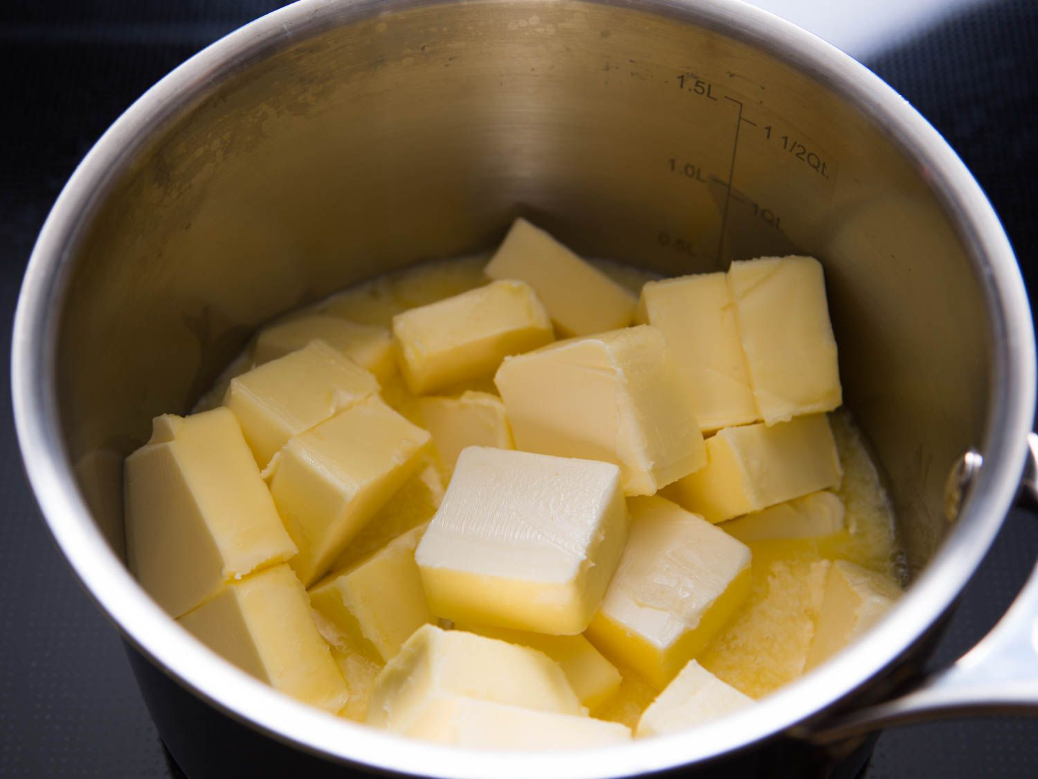 cubes of butter in a saucepot. The butter is starting to melt.