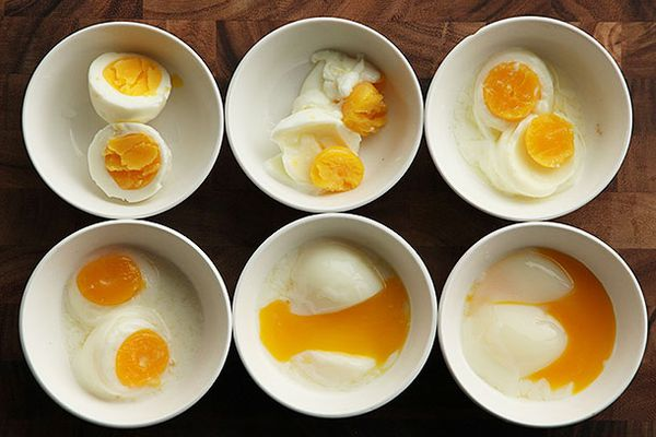 Overhead comparison shot of eggs cooked sous vide at different temperatures