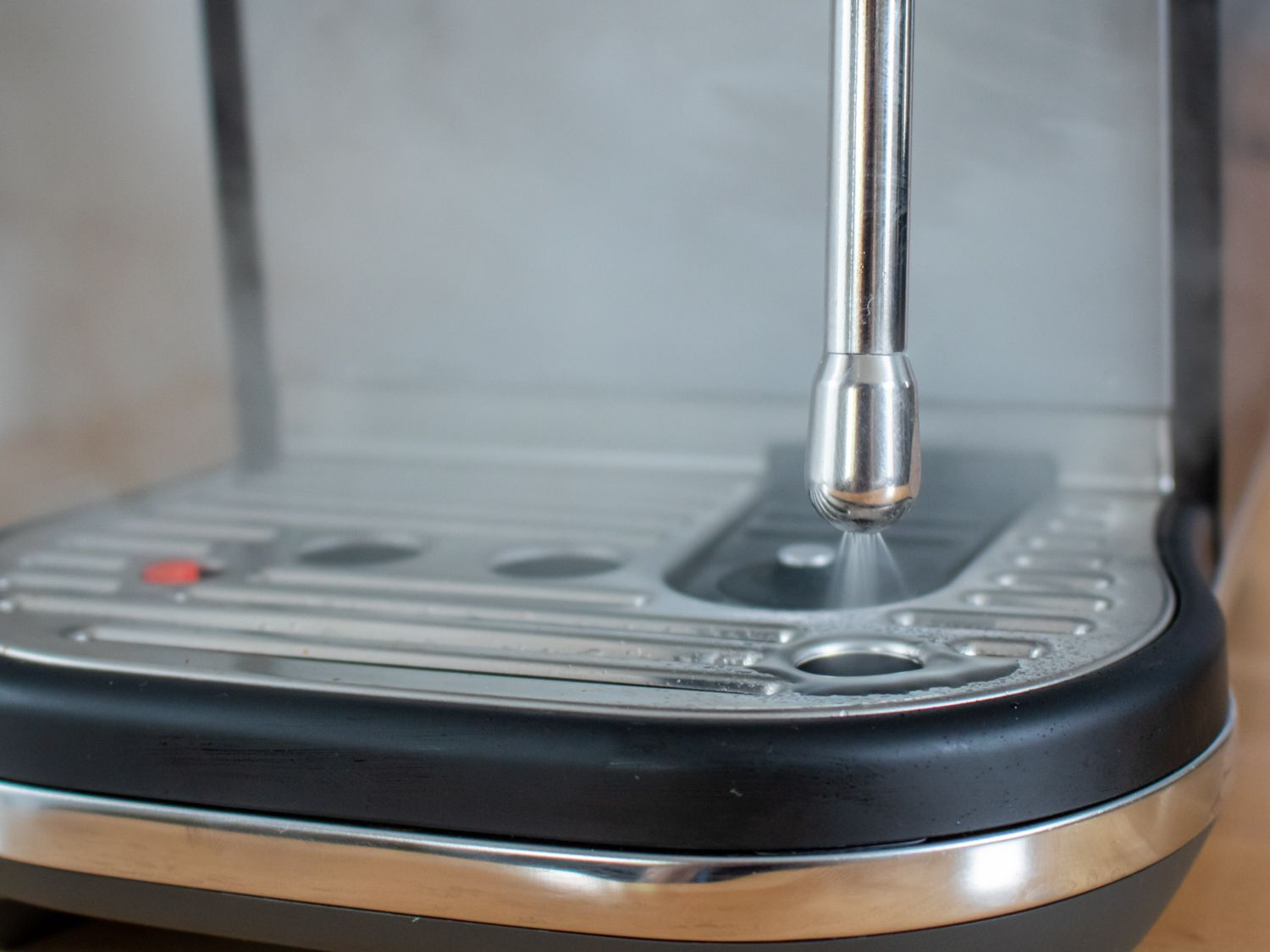 a close up of the steamer wand on the Breville Bambino plus espresso machine