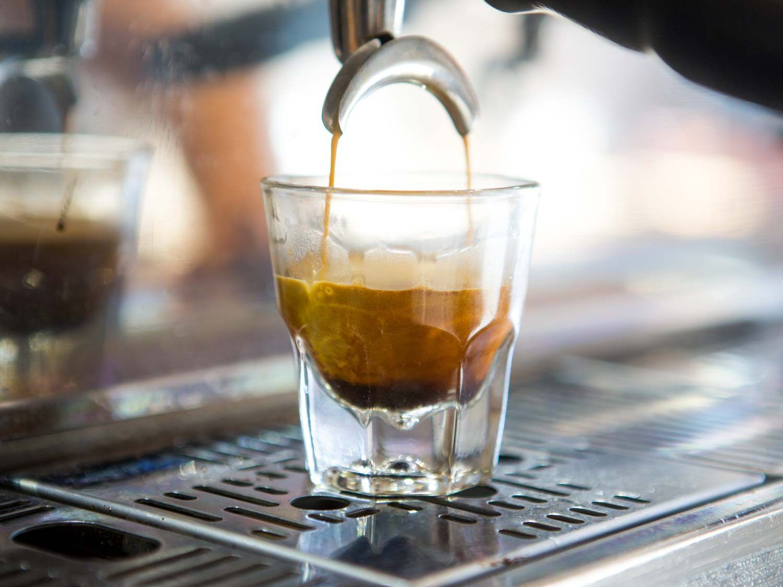 Espresso pouring into a small shot glass