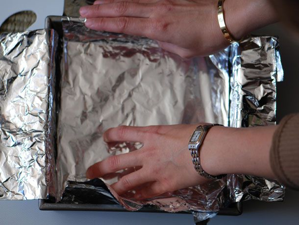line baking sheet with tin foil