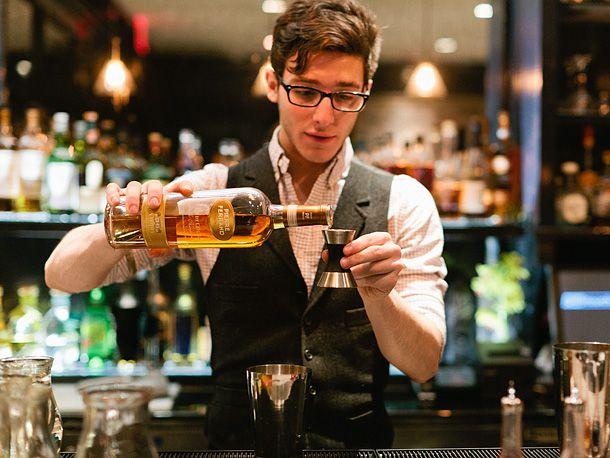 bartender pouring cognac