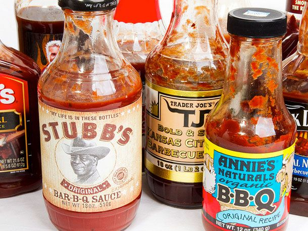An assortment of bottled barbecue sauces on a table.