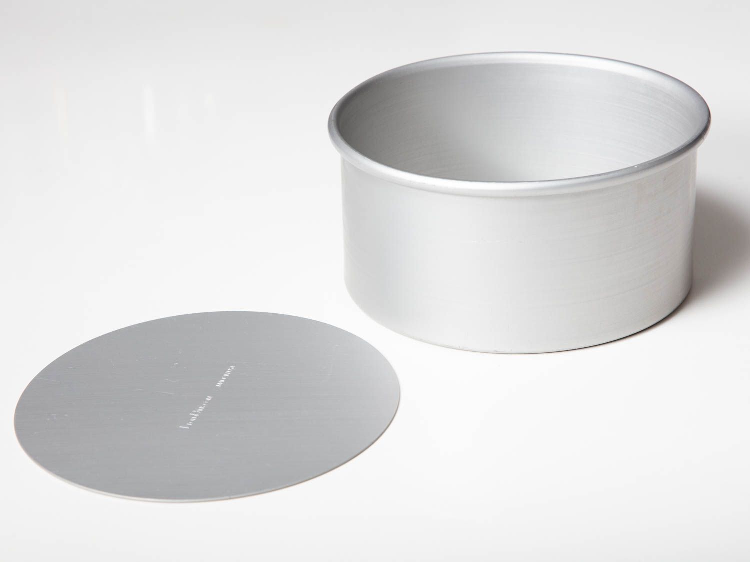 An empty aluminum cheesecake pan which was designed and manufactured specifically for this recipe