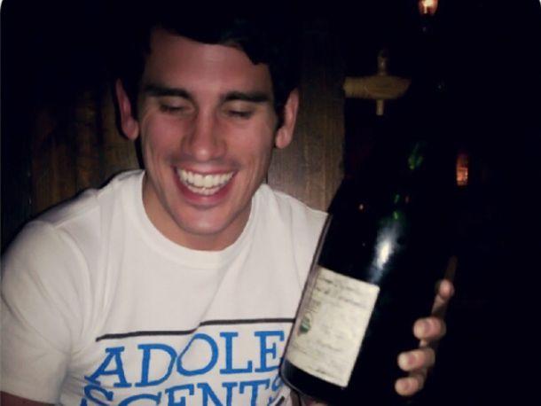 Sommelier holding bottle of wine