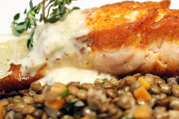 Crispy salmon with lentils du Puy and two-mustard creme fraiche.