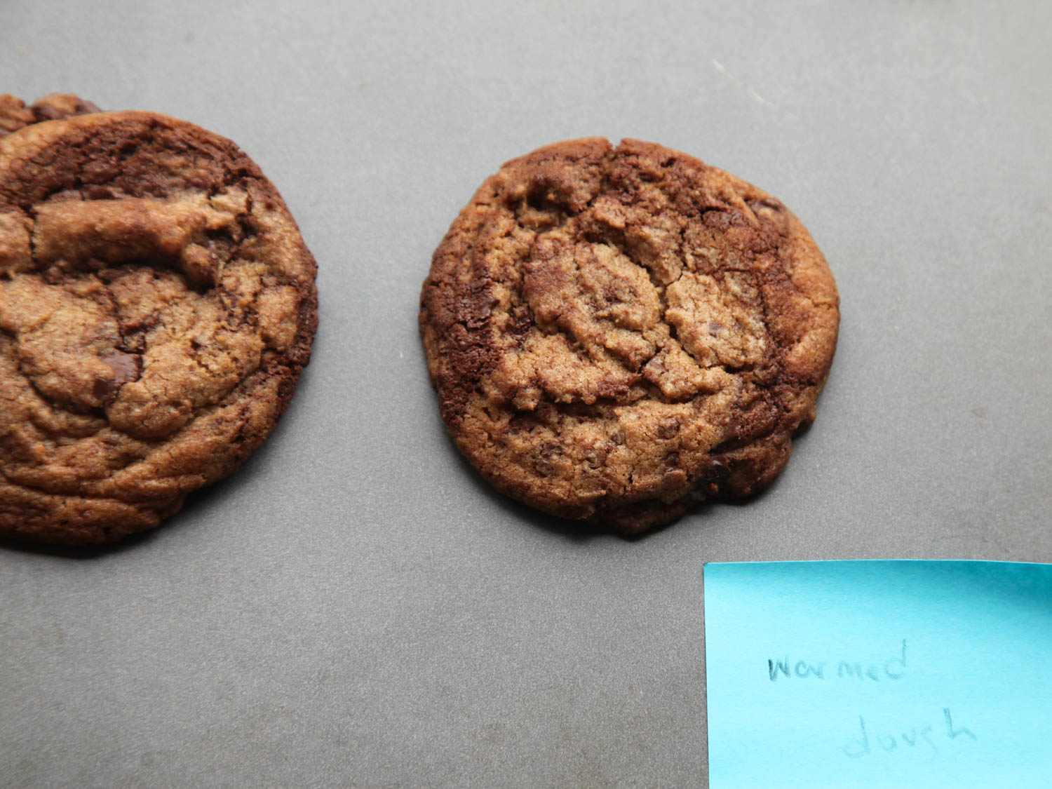 A baked chocolate chip cookie showing chocolate swirl that was the result of warmed cookie dough.