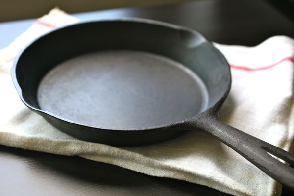 A cast iron skillet on a white kitchen towel