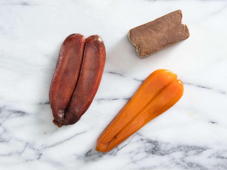 Three examples of bottarga. Clockwise from left: bottarga di muggine from l'oro di cabras; bottarga di tonno; bottarga di muggine from Smeralda